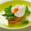 Poached egg and green asparagus — Stock Photo #8405604