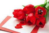 Red tulips and greeting card — Stock Photo