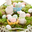 Easter bunny and chocolate eggs — Stock Photo