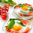 Baked egg with tomatoes and spinach — Stock Photo
