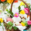 Basket with easter eggs and cake — Stock Photo #9350570