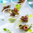 Appetizers on cocktail sticks — Stock Photo