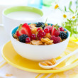 Corn flakes with fruits and milk — Stock Photo