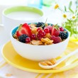 Corn flakes with fruits and milk — Stock Photo #9848524