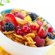 Corn flakes with fruits and milk — Stock Photo #9848546