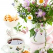 Tea,waffles and flowers — Stock Photo