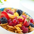 Cornflakes with milk and fruits — Stock Photo #9861664
