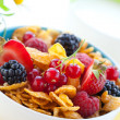 Cornflakes with milk and fruits — Stock Photo