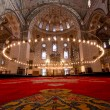 Stock Photo: Inside Istanbul Mosque with red carpet in foreground