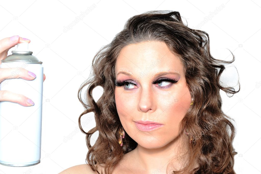 Portrait of a beautiful woman spraying hairspray  Foto de Stock   #10383806