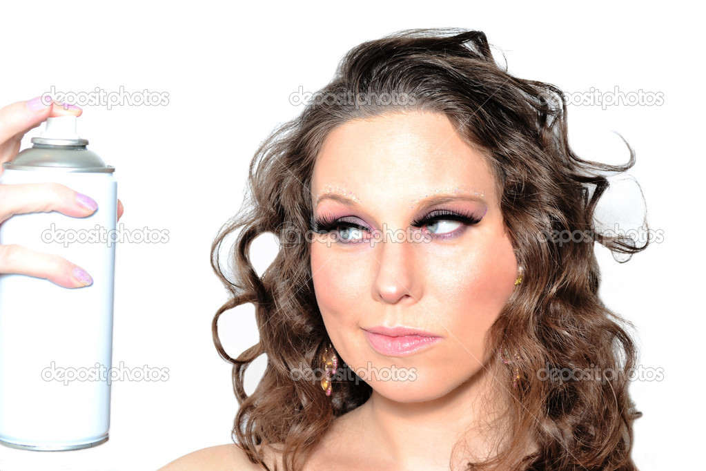 Portrait of a beautiful woman spraying hairspray  Stockfoto #10383806
