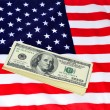 Royalty-Free Stock Photo: Dollars and US banner