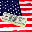 Dollars and US banner — Stock Photo #10433875