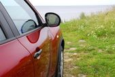 Red car on a sea coast — Stock Photo