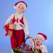 Stock Photo: Happy New year. Charming Santa helpers.