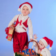 Royalty-Free Stock Photo: Happy New year. Charming Santa helpers.