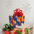 New Year's gifts in festive packaging. Red box with green ribbon, blue — Stockfoto
