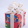Bright multi-colored gift on a white background. A gift to the birthday boy — 图库照片
