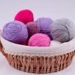 Stock Photo: Ball of yarn for knitting in basket on white background