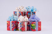 Many small gifts on a white background. — Stock Photo