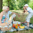 Royalty-Free Stock Photo: Family on a picnic. Son of photographs of parents mom and dad.