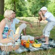 Stock Photo: Family on picnic. Son of photographs of parents mom and dad.