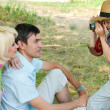 Family on a picnic. Son of photographs of parents mom and dad. — Stock Photo