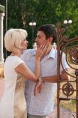 Beautiful couple, a woman stroking man's cheek. Love. — Stock Photo