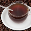 A cup of coffee on the background of coffee beans - Stockfoto