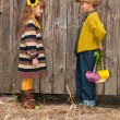 The boy gives a girl flowers. First love. — Stock Photo #9670400