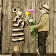 The boy gives a girl flowers. First love. — Stock Photo #9670493