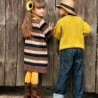 The boy with the girl peep over the fence. Photos in the old style. — Stock Photo