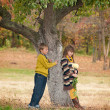 The boy with the girl standing near a tree. — Stock Photo #9671012