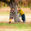 The boy with the girl standing near a tree. — Stock Photo
