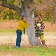 The boy with the girl standing near a tree. — Stock Photo #9671040