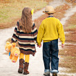 The boy with the girl go on the road holding hands. — Stock Photo