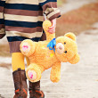 Stock Photo: Girl with teddy bear is on path.