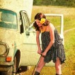 Beautiful brunette car repairs. Photos in the old style. — Stock Photo
