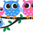 A cute owl family — Stock Vector