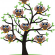 Owls in a tree — Stock Vector #9295577