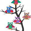 A group of owls in a tree — Stock Vector #9893625