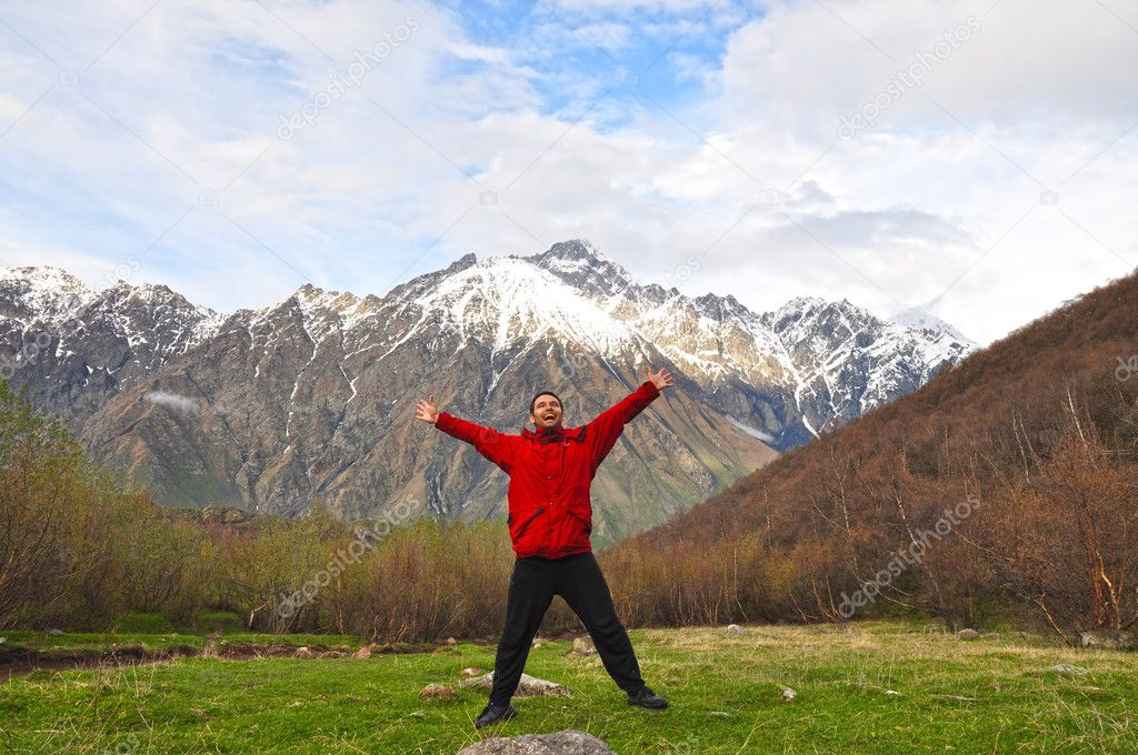 Man in the mountains of Georgia, near Mount Kazbegi — Stock Photo #8614132