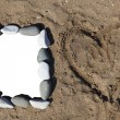 Photo frame of stones on  sand — Stock Photo