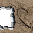 Photo frame of stones on sand — Stock Photo #10379722