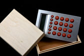 Wooden box and calculator — Stock Photo