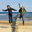 Jumping on the beach — Stock Photo #8233429