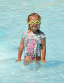 Funny child in the pool — Stock Photo