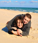 Lovers on the sand — Stock Photo