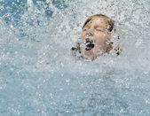 Girl playing in the water. — Stock Photo