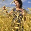 Woman in wheat. — Stock Photo